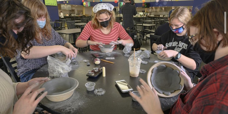 Students doing pottery